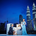 Designer Jimmy Choo (L), actress Michelle Yeoh (R) and supermodel Georgia May Jagger pose with a British Airways' Club World seat in front of the Petronas Twin Towers in Kuala Lumpur. (c) Nicky Loh