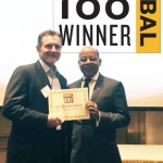 Mike Kistner, CEO, RezNext receiving the Red Herring Top 100 Asia Award from Alex Vieux, Founder and CEO of Red Herring.