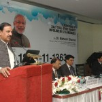 """The Minister of State for Tourism & Culture (IC) and Civil Aviation, Dr. Mahesh Sharma addressing at the launch of the """"24x7 Toll Free Multi-Lingual Tourist Info Line in 12 International Languages including Hindi & English"""", in New Delhi. The Secretary, Ministry of Tourism, Mr Vinod Zutshi and other dignitaries are also seen."""