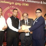 Somnath Mukherjee, GM, The Taj West End receiving the Award