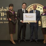 Etihad Airways cabin crew with Peter Baumgartner, Etihad Airways' Chief Executive Officer and Edward Plaisted, Chief Executive Officer of Skytrax, at announcement which was held in the airline's Innovation Academy in Abu Dhabi.