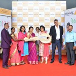 Renu Jain, Chairperson, Trikaal Inc and Bharat Malkani, past President, HRAWI handover the keys to Weaker Section Women at the food truck launch event