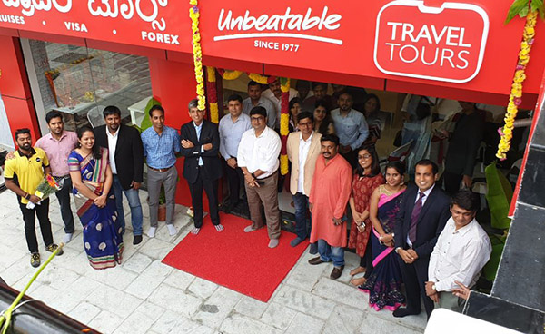 Rakshit Desai, Managing Director, India at Flight Centre Travel Group with Travel Tours Team at newly inaugurated retail store at Bengaluru