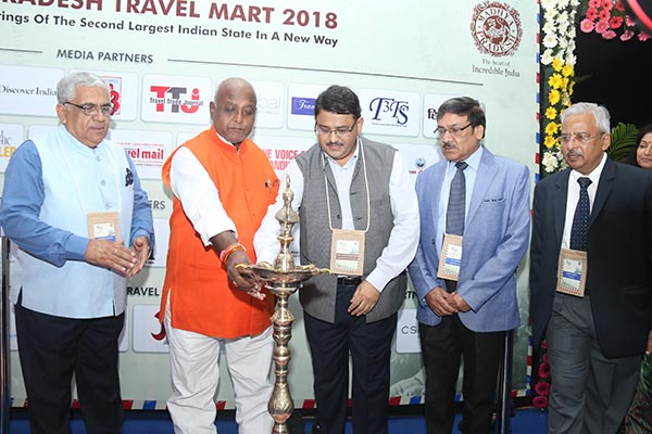 Shri Pramod Kumar, Tourism Minister, Govt. of Bihar and Mr. Hari Ranjan Rao (IAS) Managing Director, Madhya Pradesh Tourism Board & Principal Secretary lighting the lamp at MPTM in Bhopal. Mr. Swadesh Kumar, President ATOAI, Mr. P P Khanna, President and Mr Anil K Rajput, Joint Secretary ADTOI are also seen.